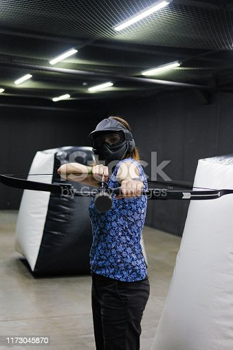 902406974 istock photo Female with crossbow arrows bow. The Archer takes aim, sharpshooter. Crossbow club. 1173045870