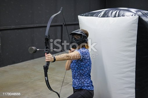 902406974 istock photo Female with crossbow arrows bow. The Archer takes aim, sharpshooter. Crossbow club. 1173046555