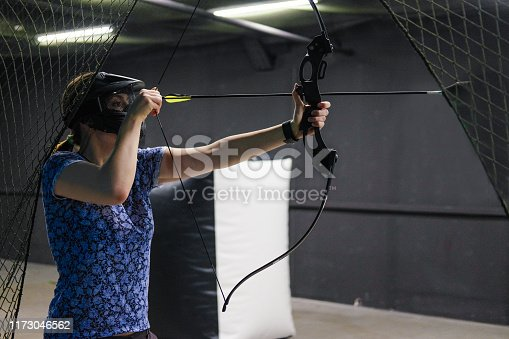 902406974 istock photo Female with crossbow arrows bow. The Archer takes aim, sharpshooter. Crossbow club. 1173046562