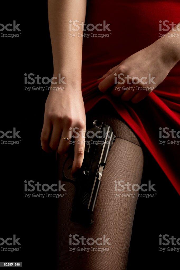 female with gun stock photo