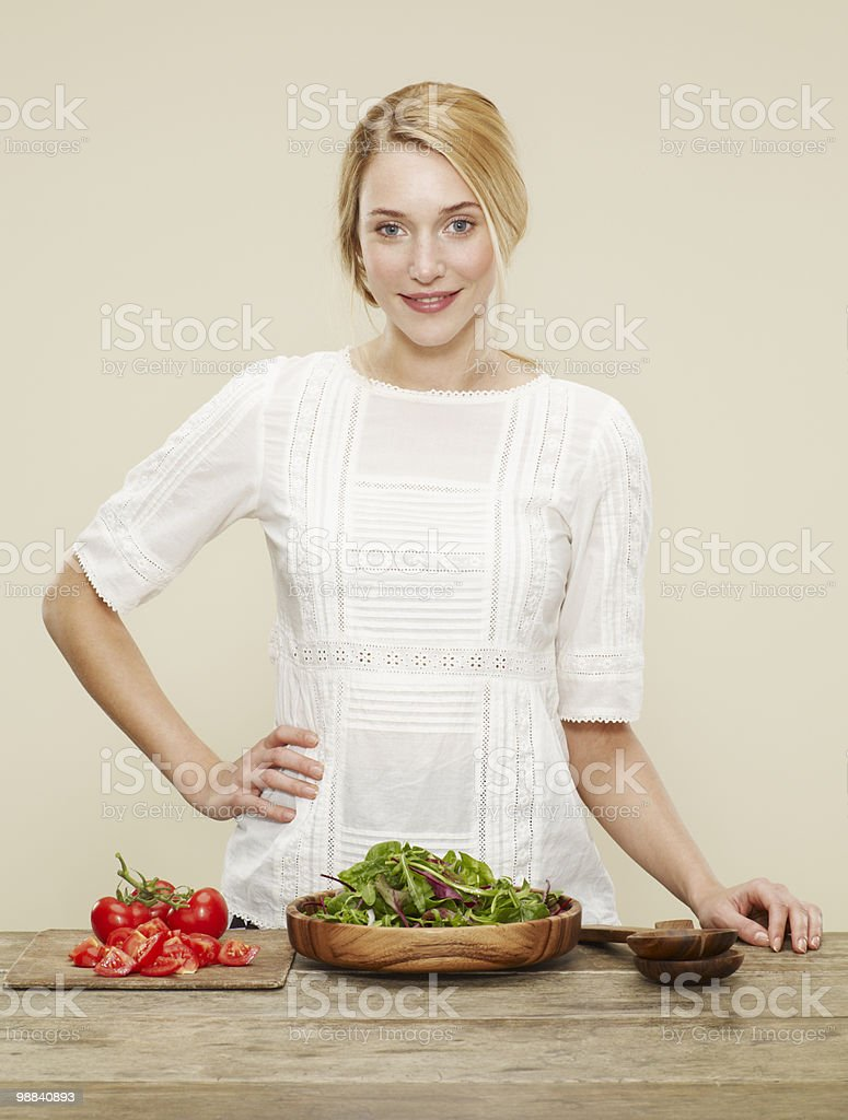 female with ingredients for a fresh salad royalty free stockfoto