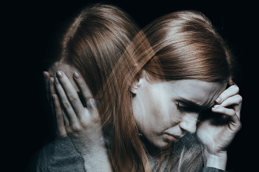 Female With Mood Disorder Stock Photo - Download Image Now