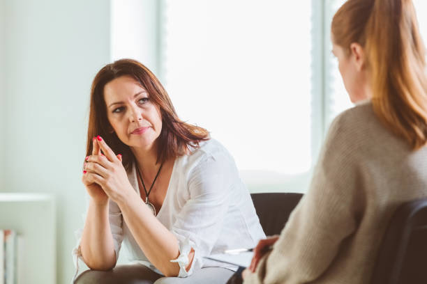 Female with psychotherapist at community center stock photo