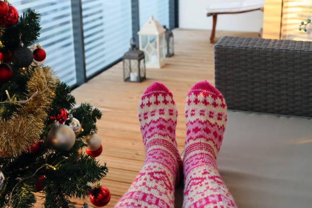Female with Wool Socks Enjoying Christmas Holiday Season on a Balcony stock photo