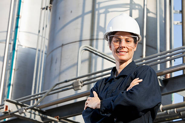 female worker at an industrial plant - refinery stock photos and pictures