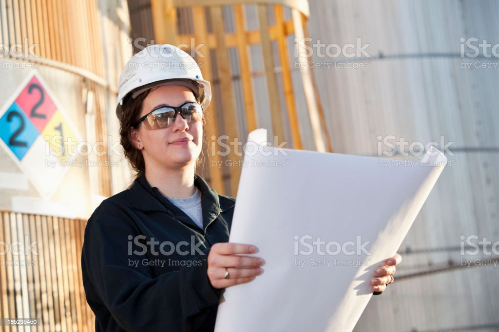 Female worker at chemical plant royalty-free stock photo