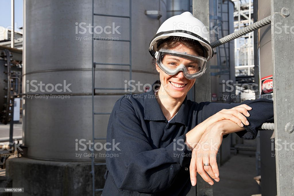 Female worker at industrial plant stock photo