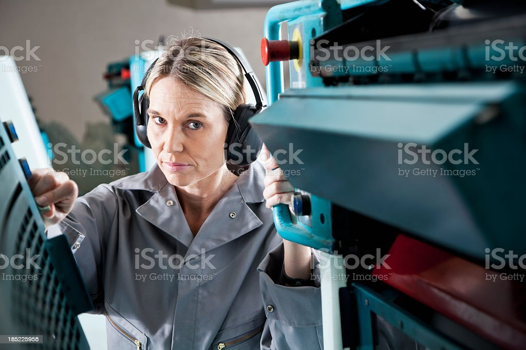 Female worker at printing plant royalty-free stock photo