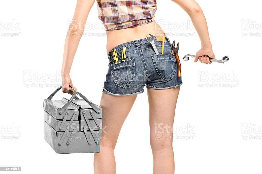 Female worker holding a wrench and tool box royalty-free stock photo
