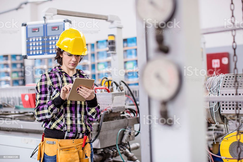 Female worker in a factory stock photo