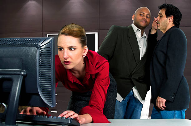 Female Worker in an Office Sexually Harassed by Businessmen stock photo