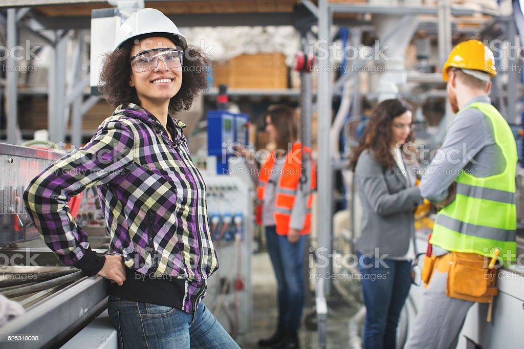 Female worker in the factory posing for the camera stock photo