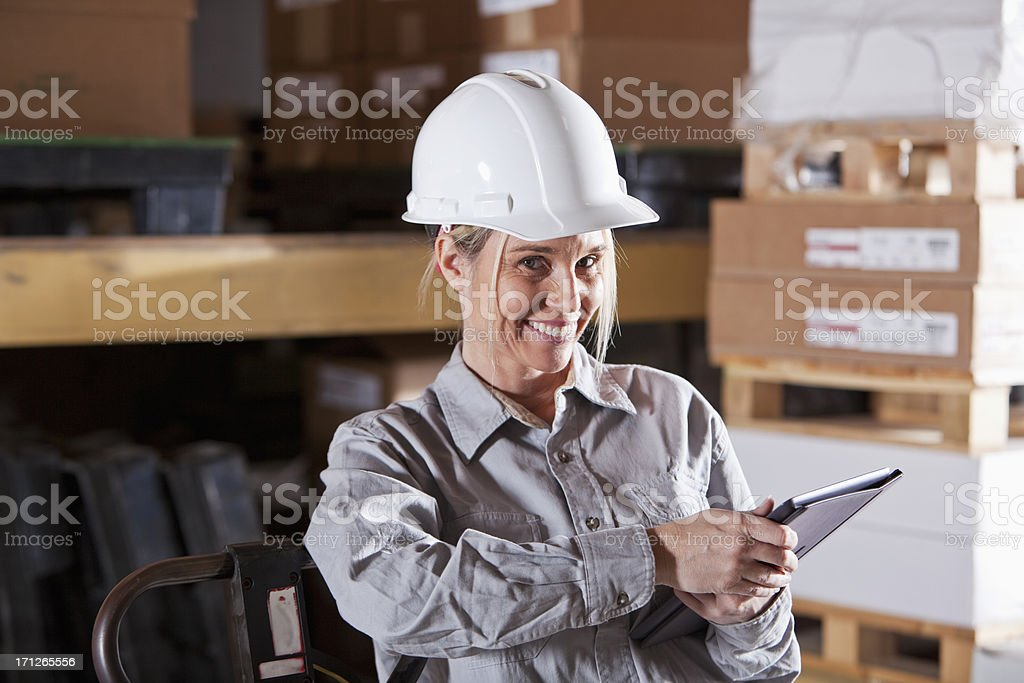 Female worker in warehouse with digital tablet royalty-free stock photo