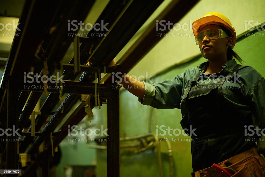 Female worker of assembly line stock photo