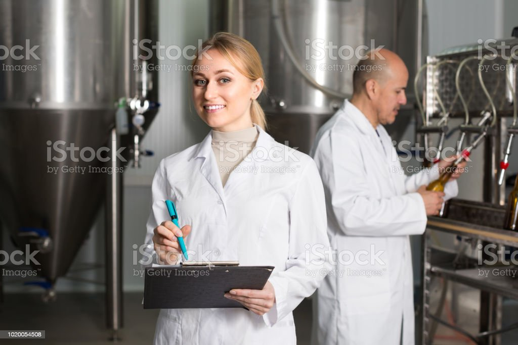 Female worker on beer brewery stock photo