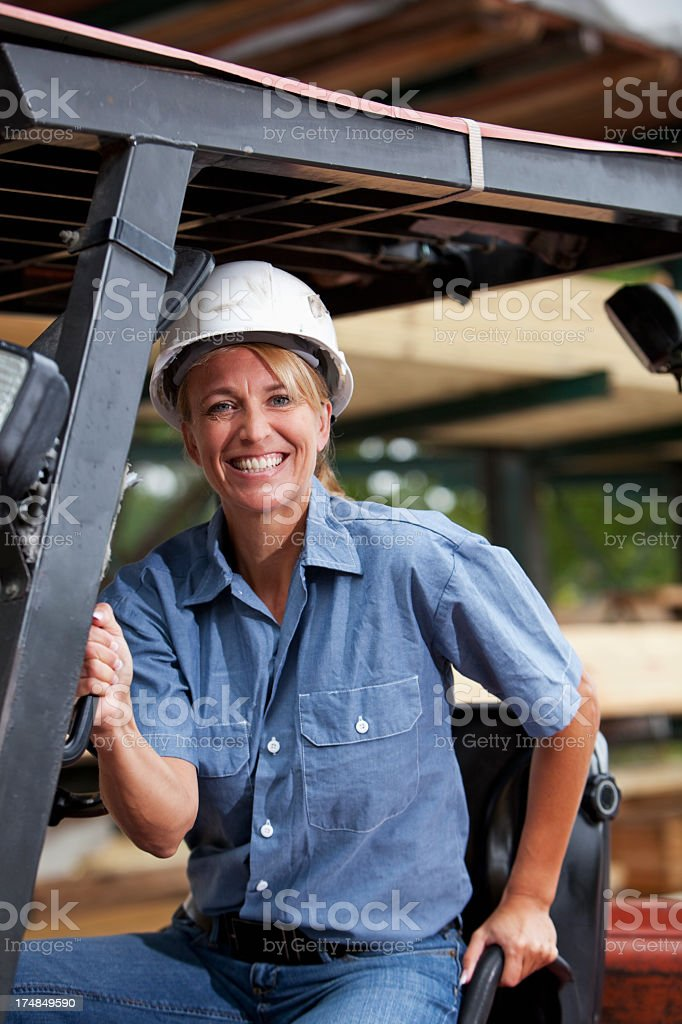 Female worker on forklift royalty-free stock photo