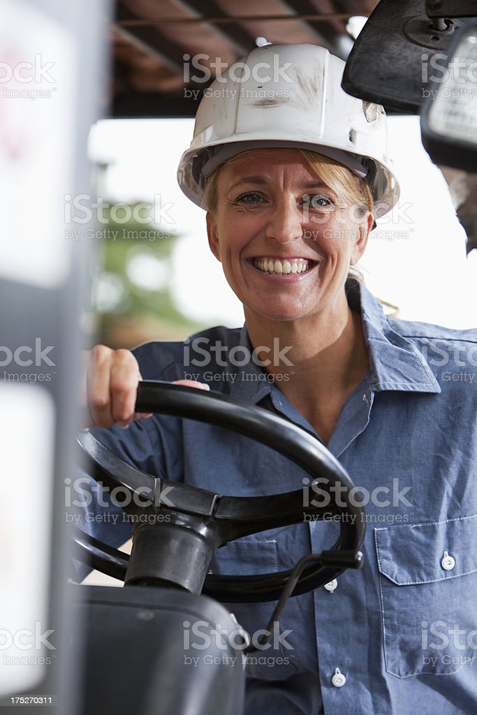 Female worker on forklift stock photo