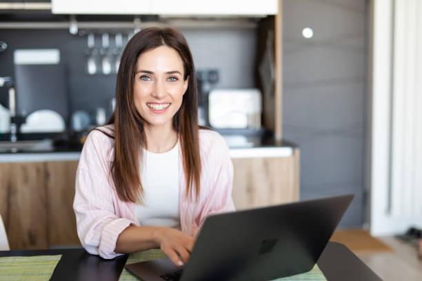 Female worker texting using laptop and internet, working online. Freelancer typing at home office, workplace. Female teleworker texting using laptop and internet, working online. Freelancer typing at home office, workplace. copywriter stock pictures, royalty-free photos & images