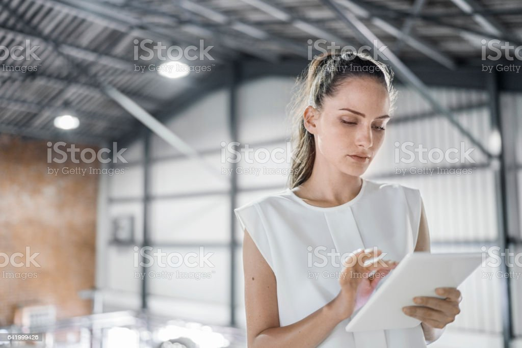 Female worker using digital tablet at brewery stock photo