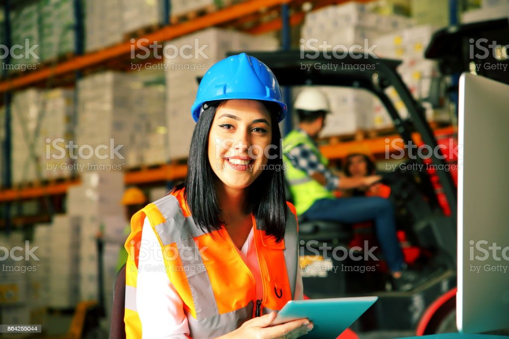 Female Worker Using Tablet Computer In Distribution Warehouse royalty-free stock photo