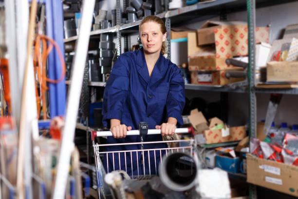 Female worker walking in build store stock photo