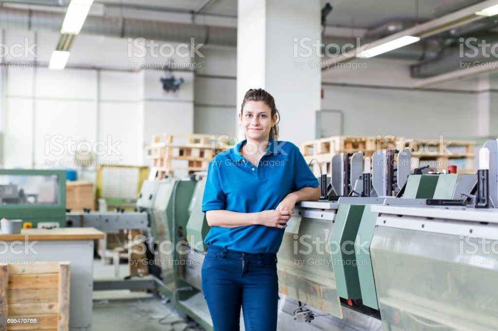 Female worker working in printing plant stock photo