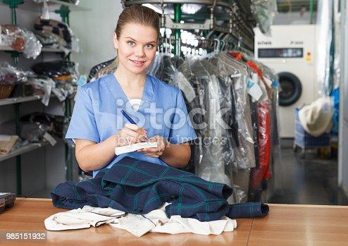 istock Female worker writing receipt 985151932