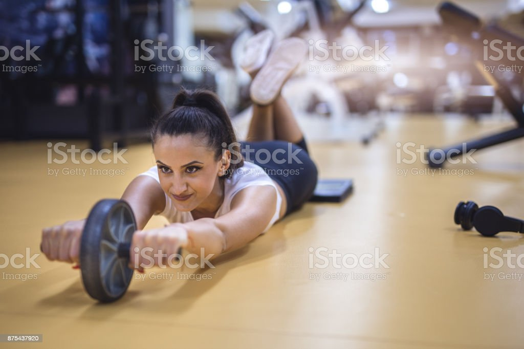 Female working abs workout stock photo