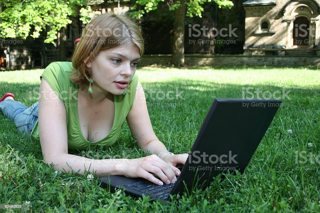 Female Working on Laptop in Park royalty-free stock photo