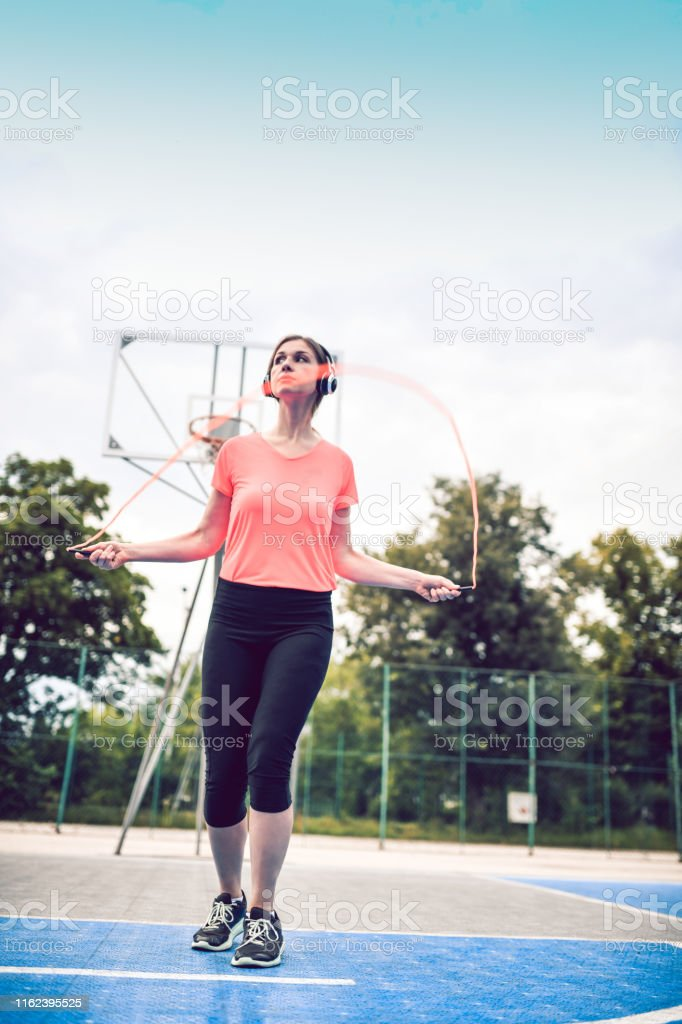 Female Working Out With Fitness Rubber Band