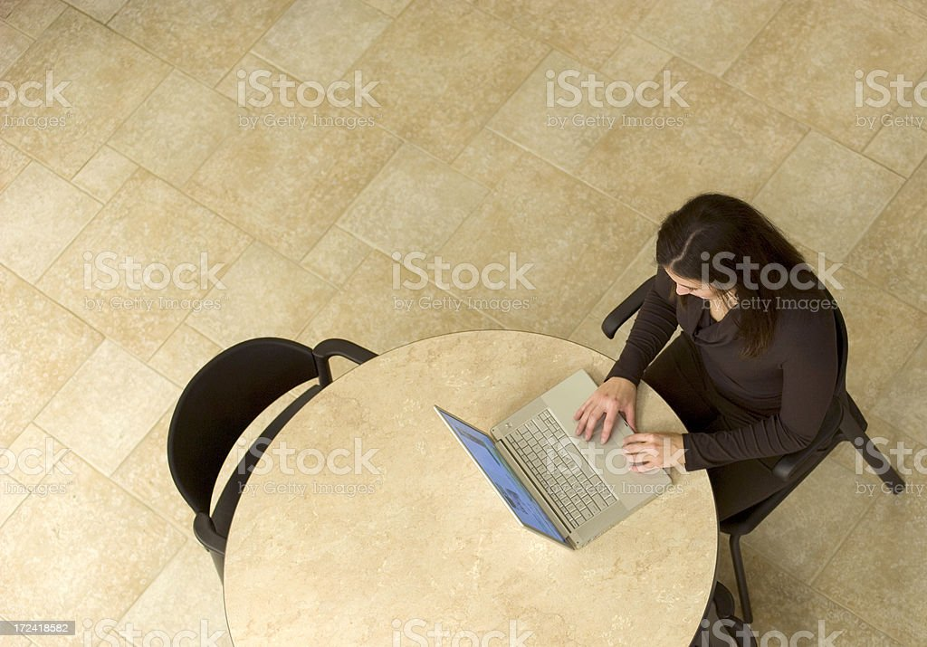 Female works on computer while waiting. royalty-free stock photo