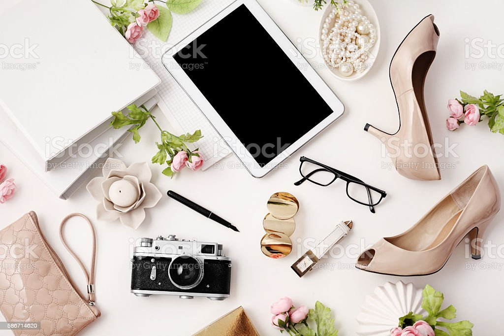 female workspace with tablet stock photo