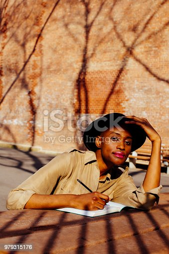 istock Female writing outside and looking at camera 979315176