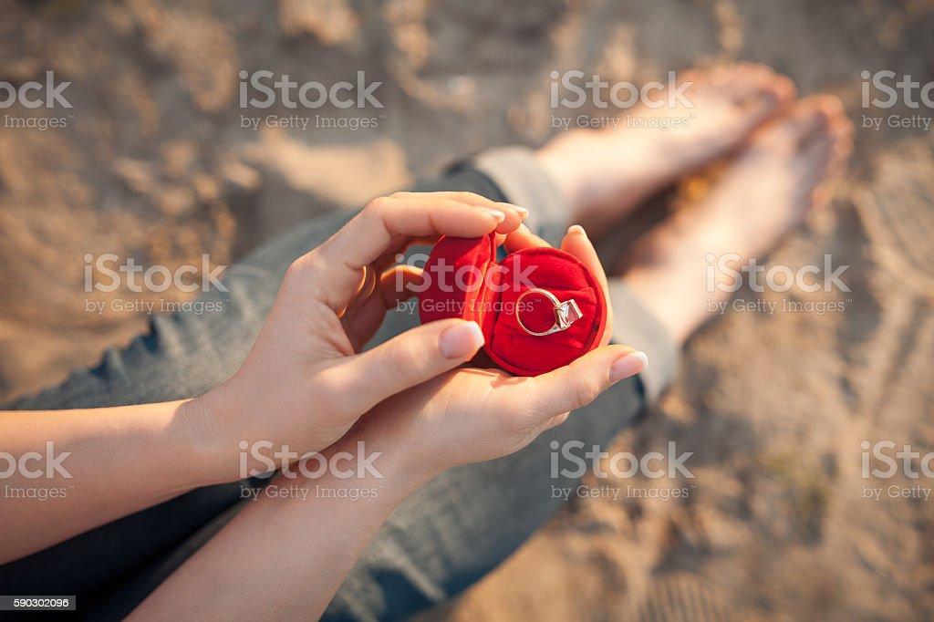 female's hand hold gift box with golden engagement ring; royaltyfri bildbanksbilder