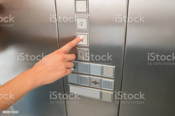 Females hand pressing first floor button in elevator picture id860610040?b=1&k=6&m=860610040&s=612x612&h=gkgipp7hfbrag5ut9vhnql8m 6ctldbix3 evp7833o=