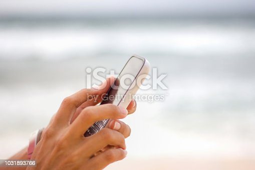 istock Females hand typing message on smartphone 1031893766