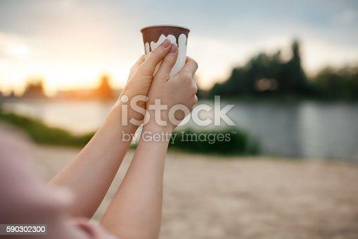 Females Hands Keep Paper Cup Coffee Near Lake Or River-foton och fler bilder på Dricka