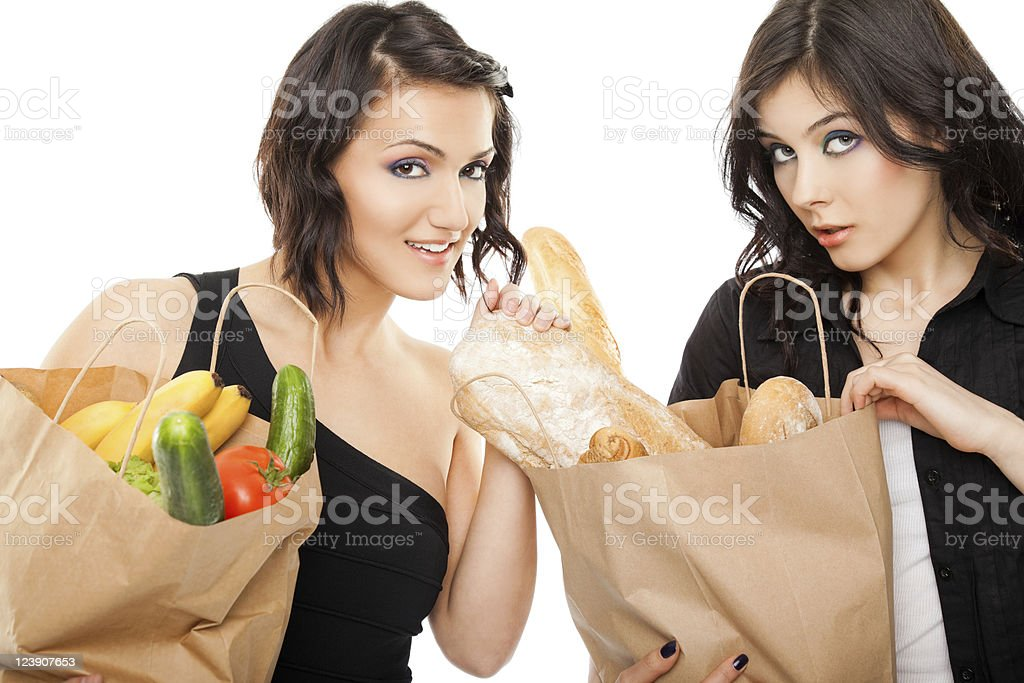 females holding shooping bags groceries royalty-free stock photo