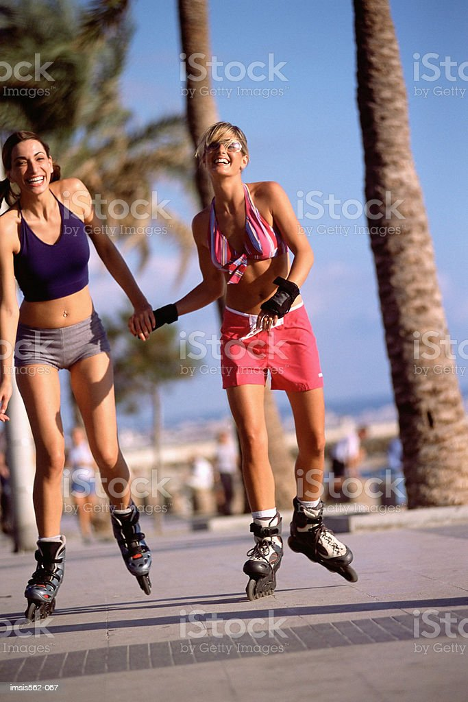 Females in-line skating royalty-free stock photo