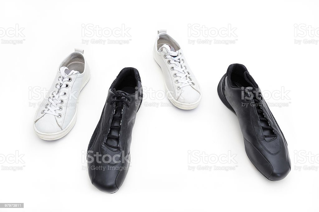 Feminine and male gym shoes royalty-free stock photo