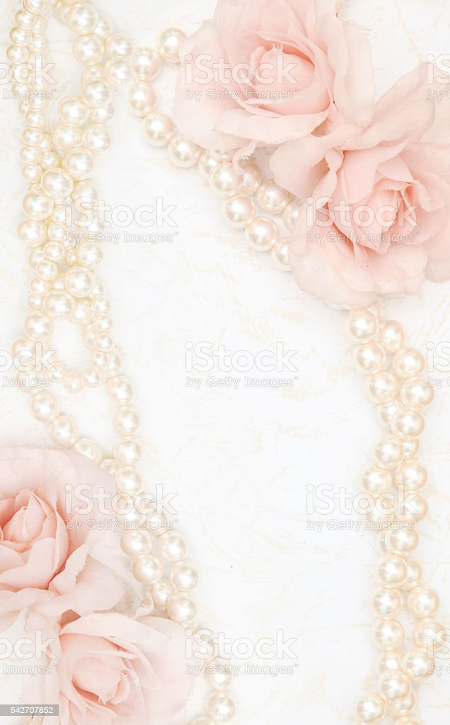 Feminine background with roses and pearls stock photo