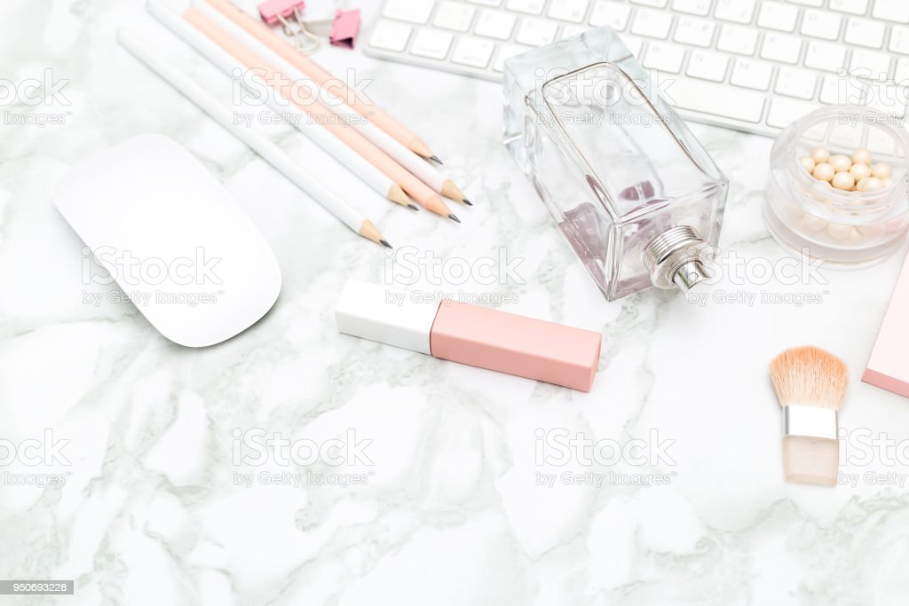 Feminine desktop with stationery and beauty. Marble background stock photo