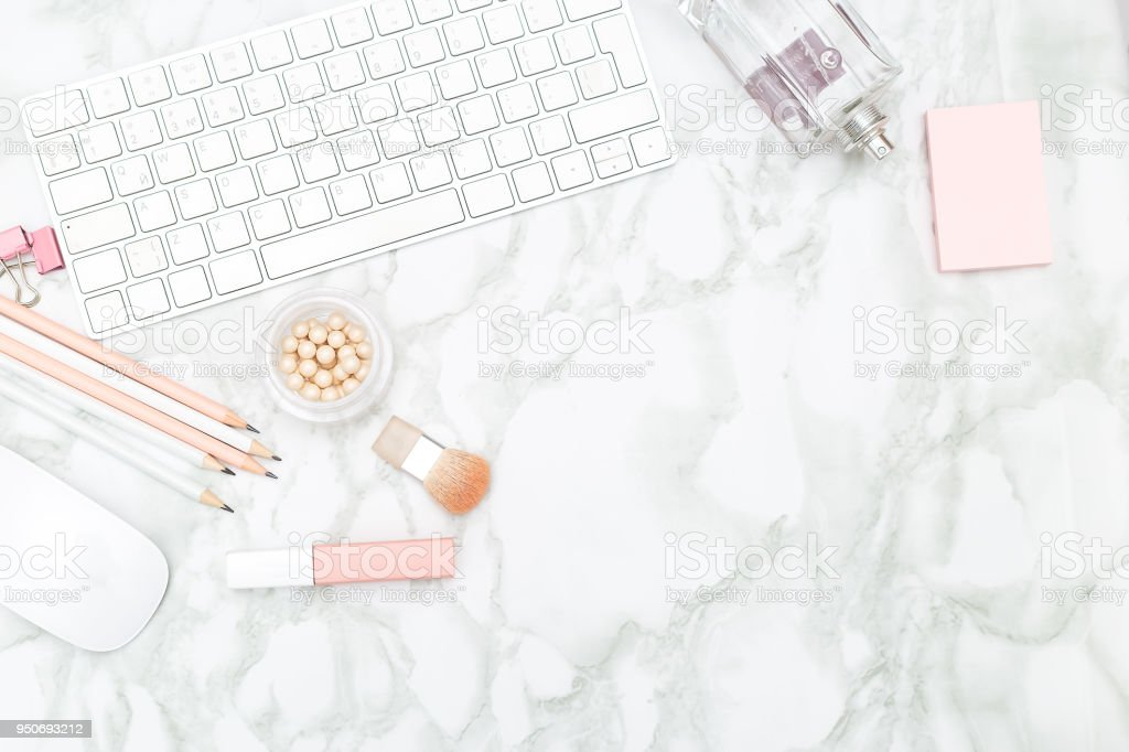 Feminine desktop with stationery and perfume. Copy space stock photo