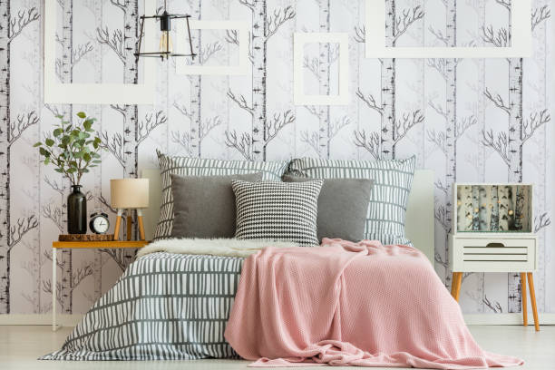 Feminine forest inspired bedroom stock photo