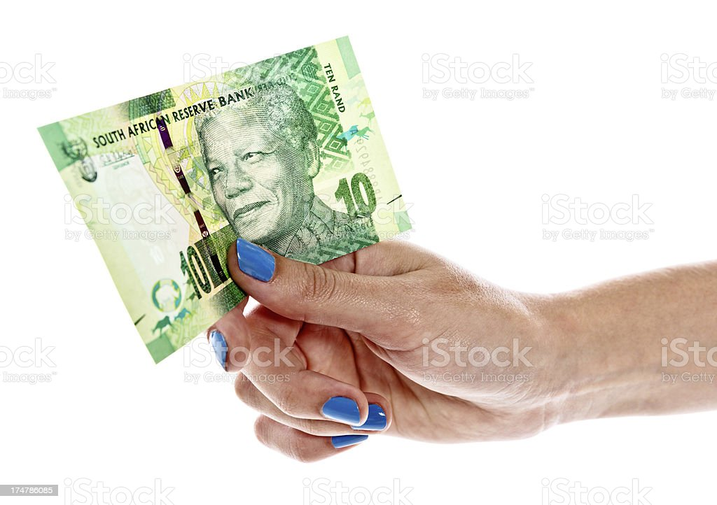 Feminine hand holding up new South African Ten Rand banknote stock photo