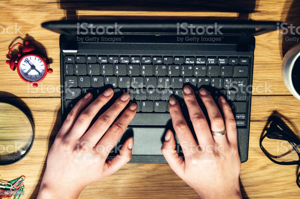 Feminine hands  hand type ing on the keyboard stock photo