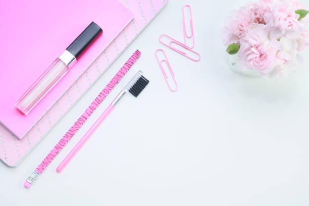 A feminine pink desktop. stock photo