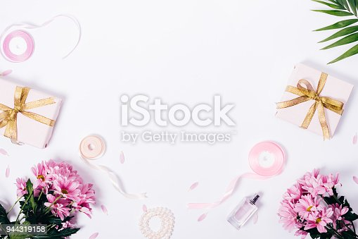 istock Feminine top view frame with copy space 944319158