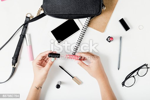 831932306 istock photo Feminine workspace in flat lay style with female accessories 837982754