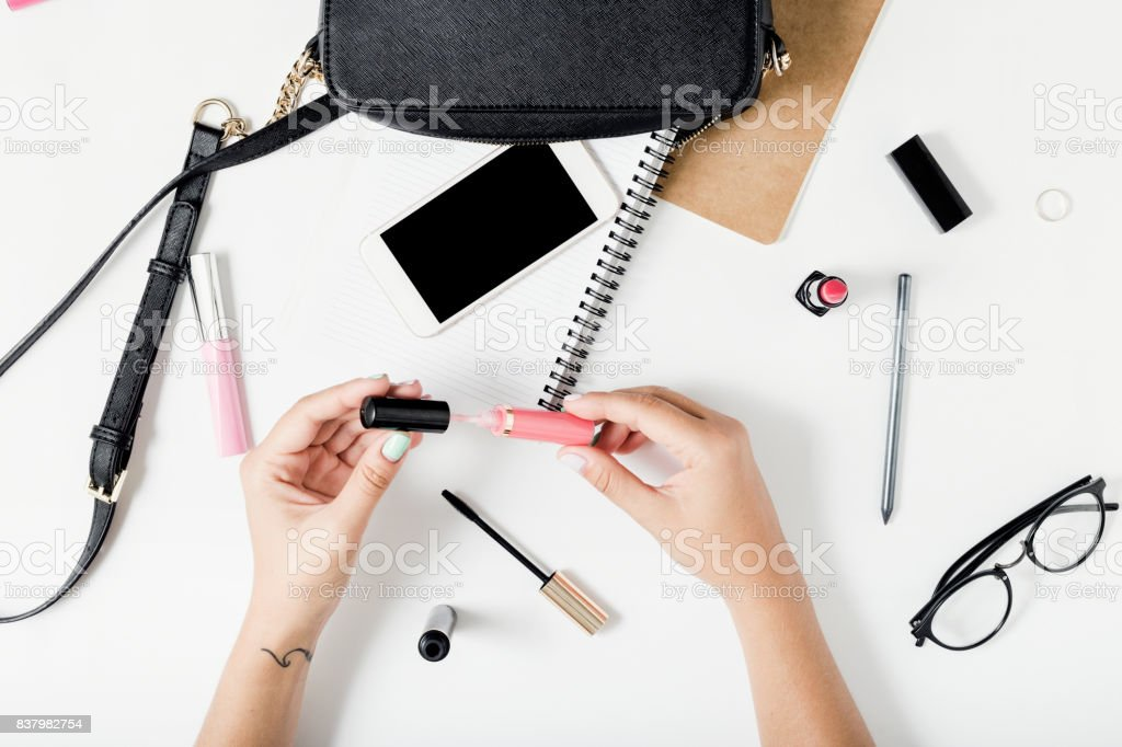 Feminine workspace in flat lay style with female accessories stock photo